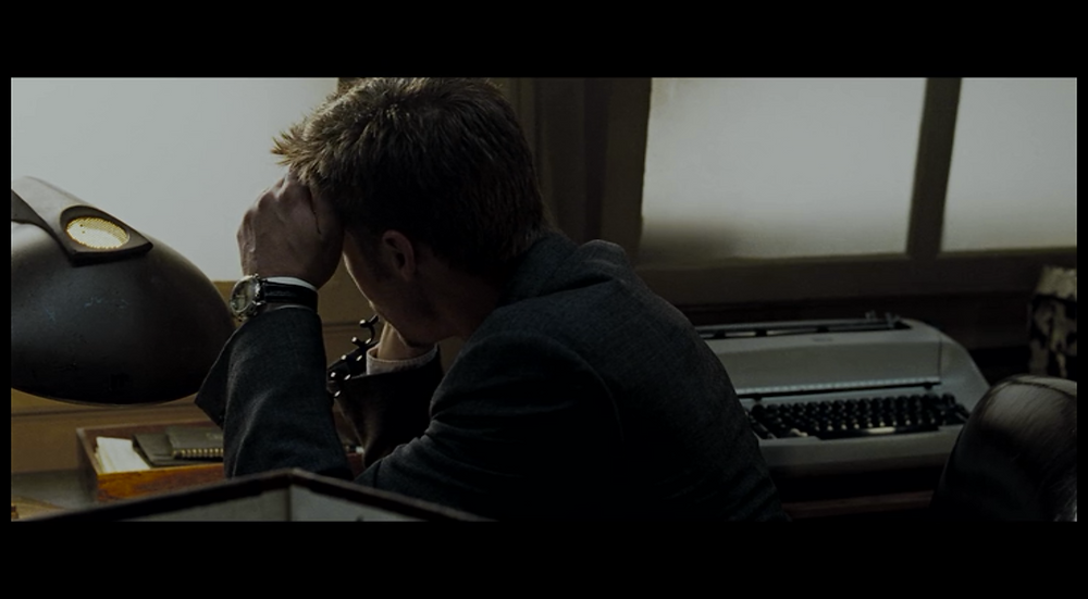 David Fincher Film Analysis Profile Shot - Mills leans forward