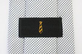 黄色いロゴ刺繍の織りネーム