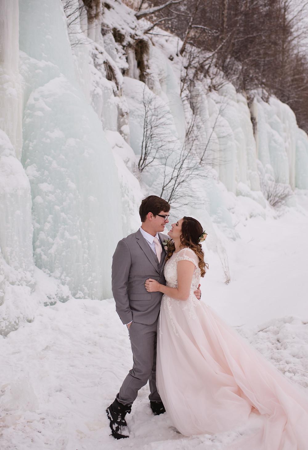 Alaska winter elopement with frozen water fall, ice fall