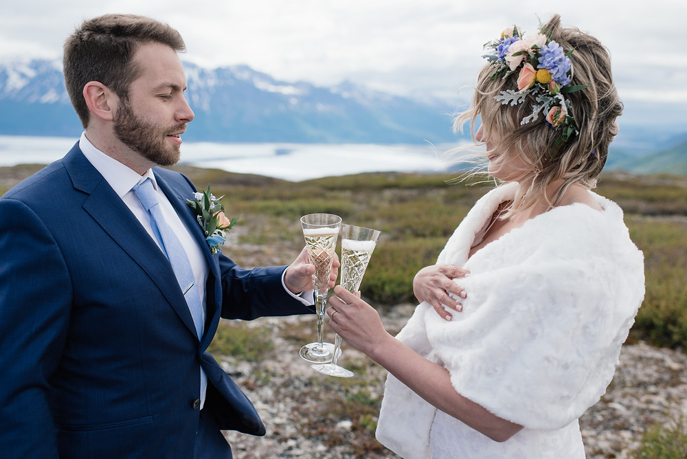 toast to love in a remote location in alaska for your wedding reception