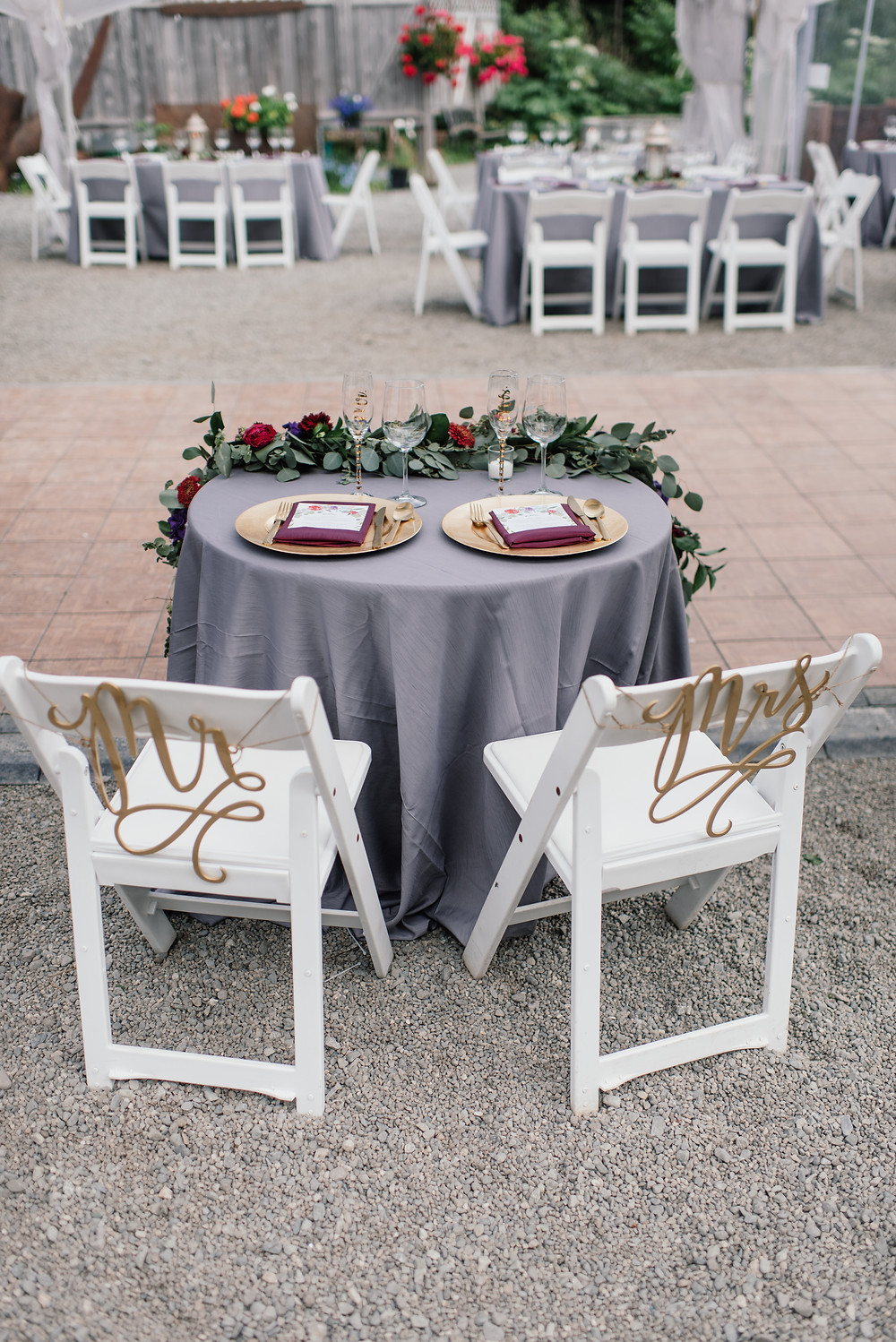 sweet heart table with charcoal and jewel tones, with floral garland