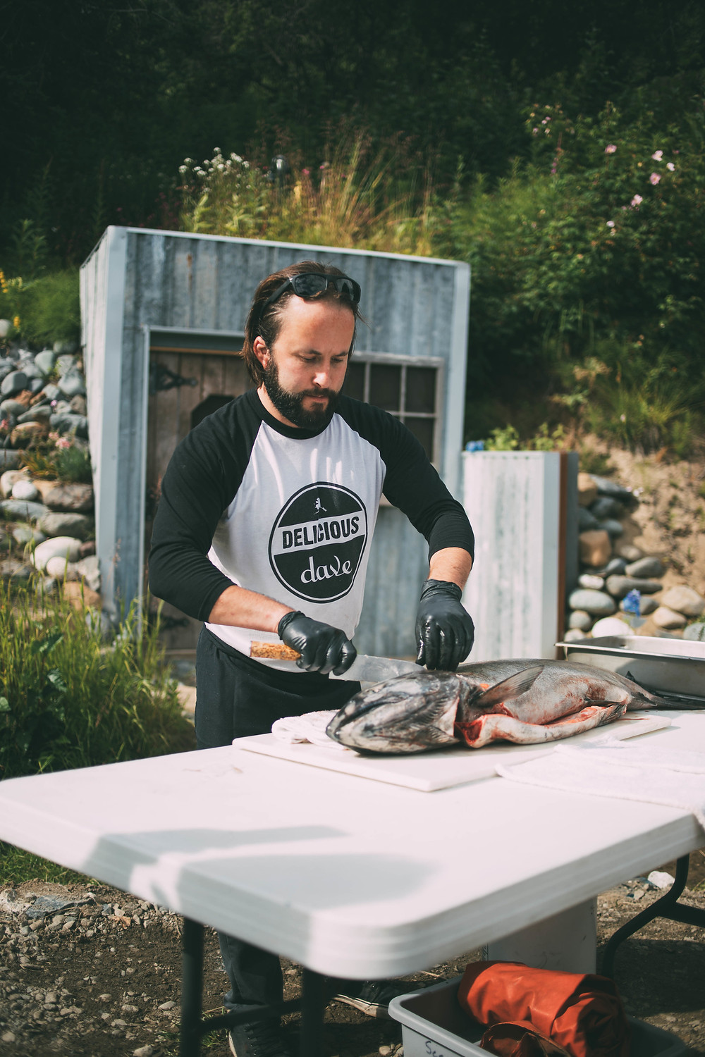 Delicious Dave catering Alaska, demonstrating how to filet a king salmon