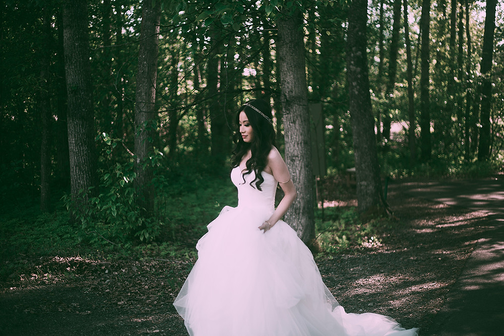 Bride in woods, alaska wedding planner