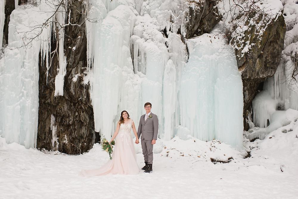 Snowy winter elopement with frozen waterfall