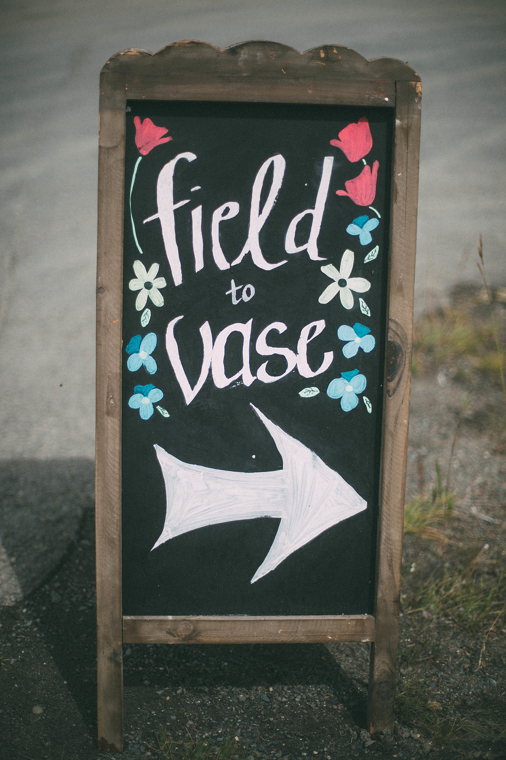 field to vase chalkboard sign