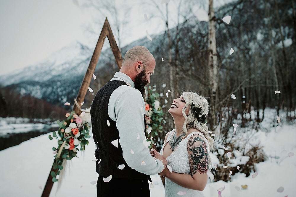 Winter styled Alaska elopement with triangle arch