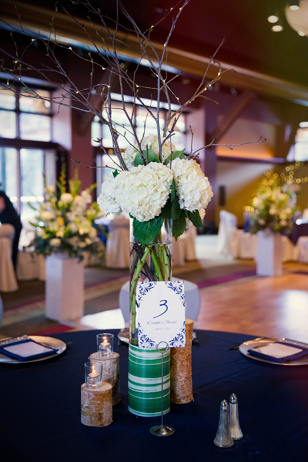 Tall white wedding centerpiece with branches