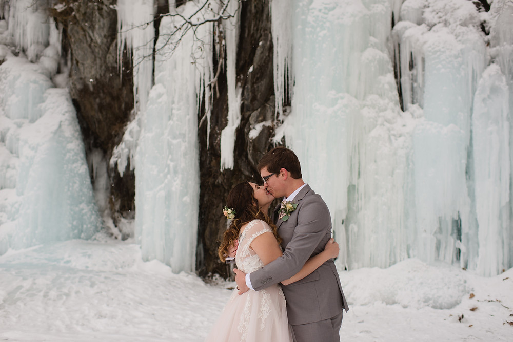 Alaska winter elopement, snow and icy frozen water falls