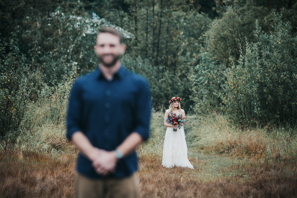 alaska elopement ceremony and first look in Moose Meadows Girdwood Ak