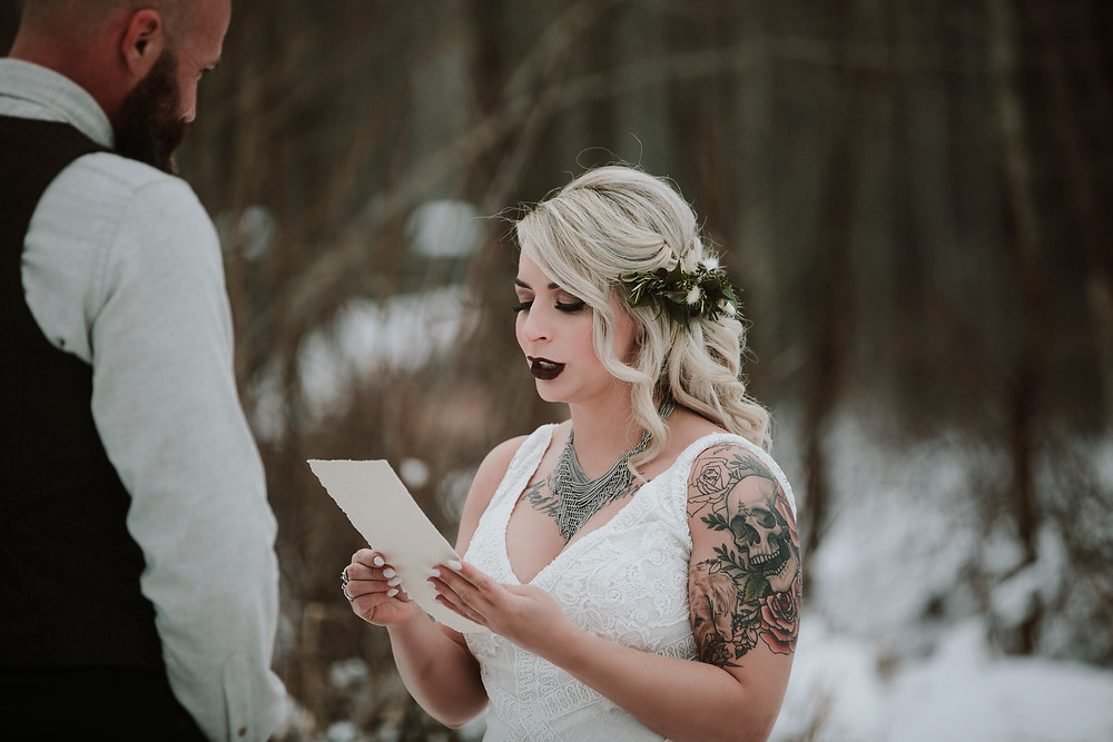 Handmade wedding vows and hair greenery at Eklutna Tail Race Alaska elopement