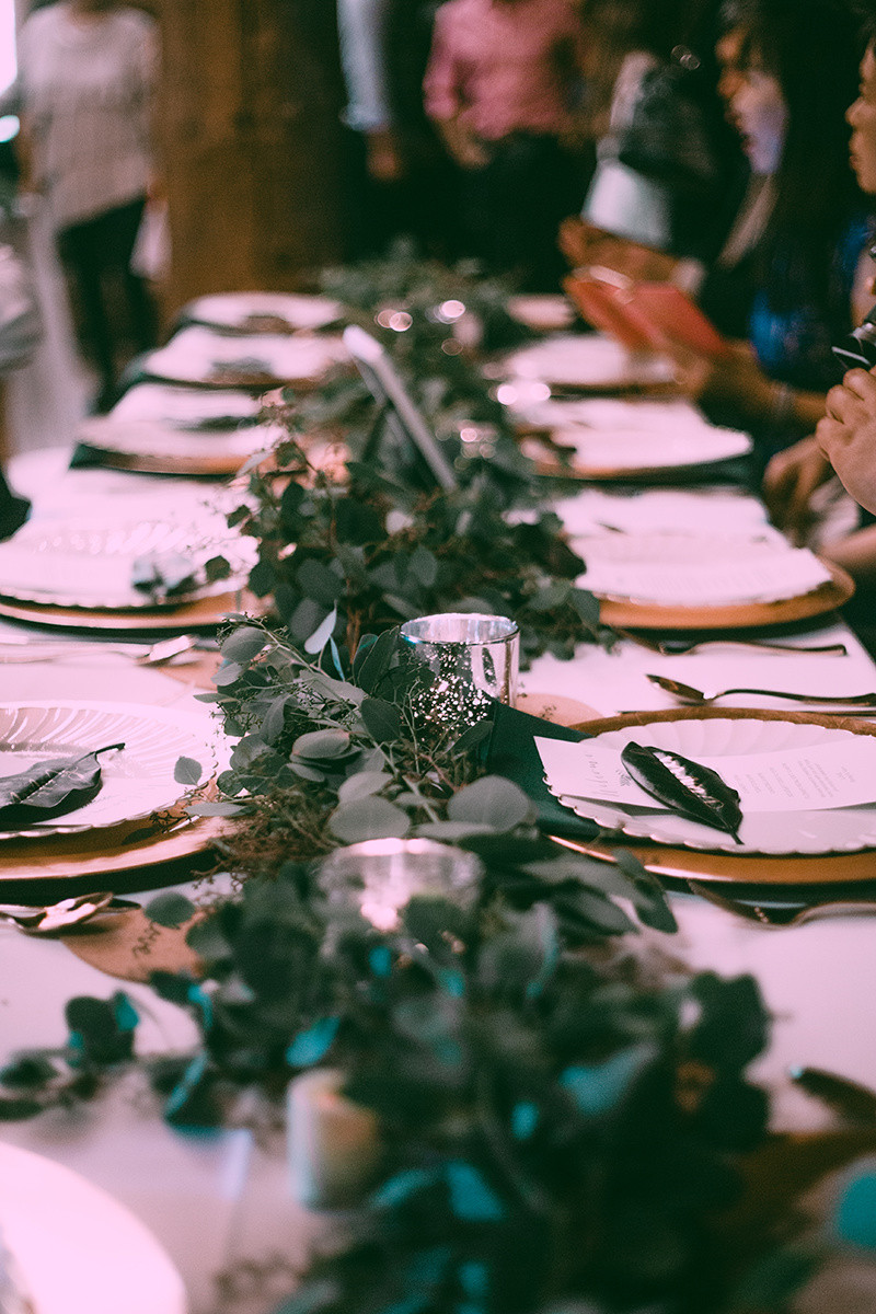 Greenery runner, gold chargers and mercury glass candles. Alaska wedding planner and styling