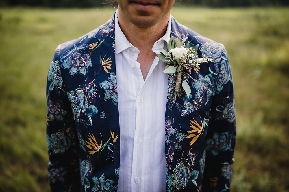 Alternative wedding celebration, men's fashion and boutonniere in Alaska