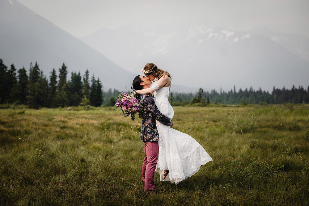 Alaska elopement in Girdwood. Simple ceremony with mountain backdrop.