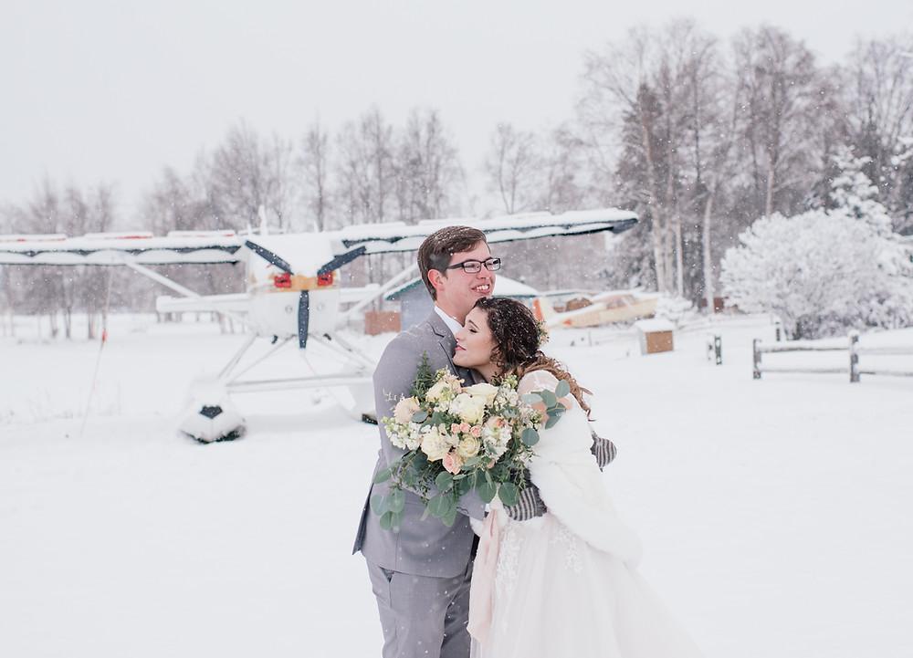 Snowy winter Alaska elopement, bush plane location backdrop