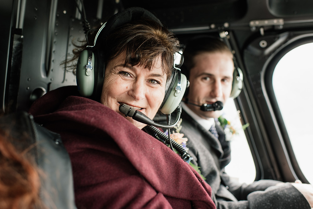Helicopter flight to alpine ceremony location, remote Alaska elopement