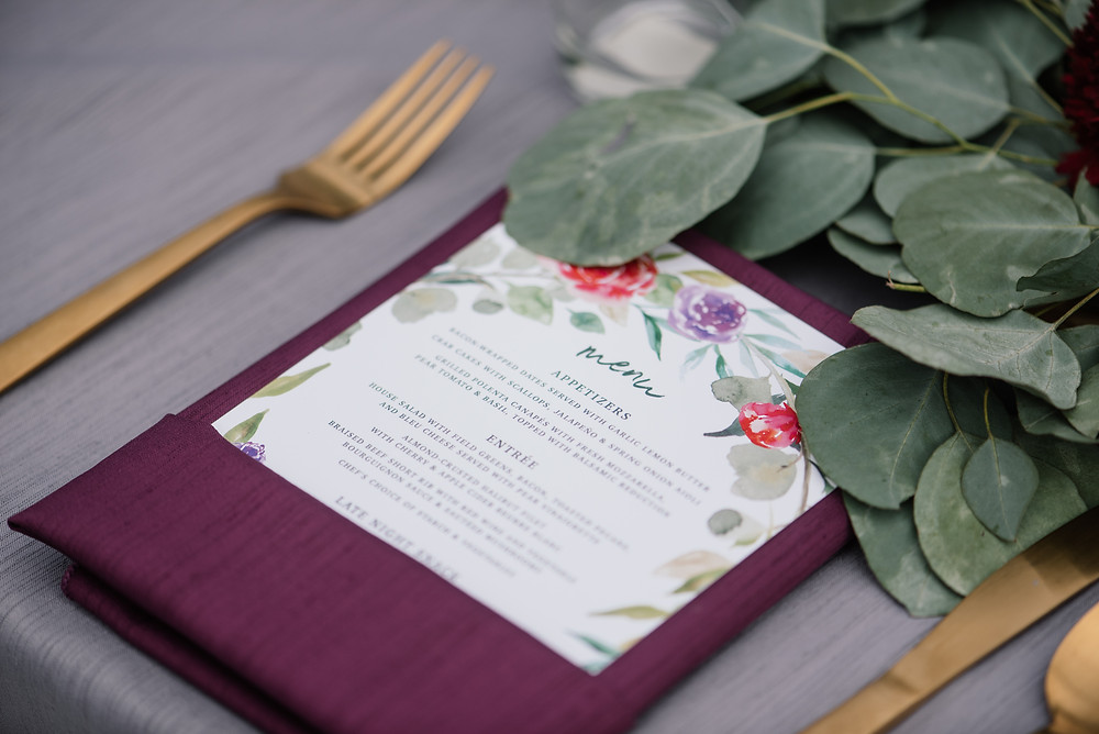 dupioni silk raspberry napkins with charcoal table cloth and gold flatware