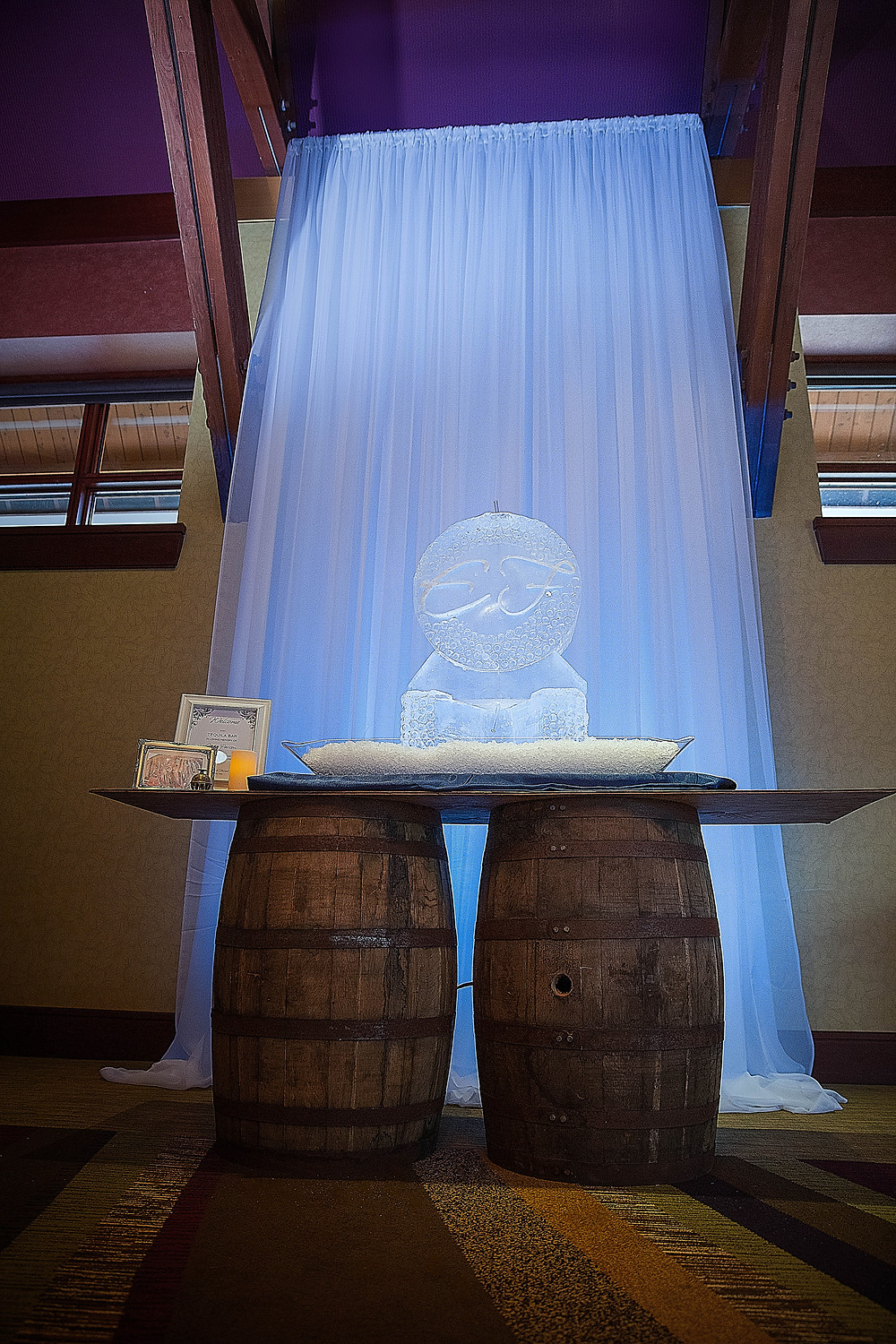 Memorial Ice luge and tequila shots on whiskey barrel bar