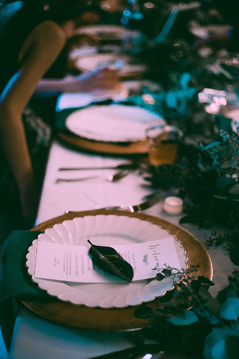 Gold charger and greenery runner wedding