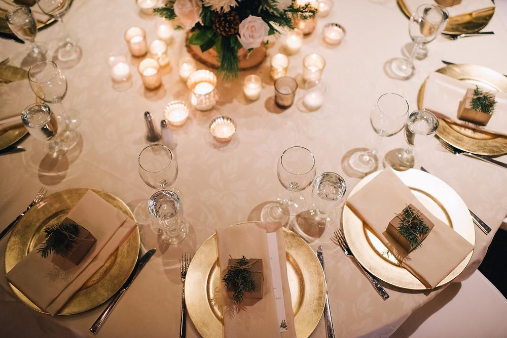 candlelit Alyeska wedding reception, gold chargers with blush napkins