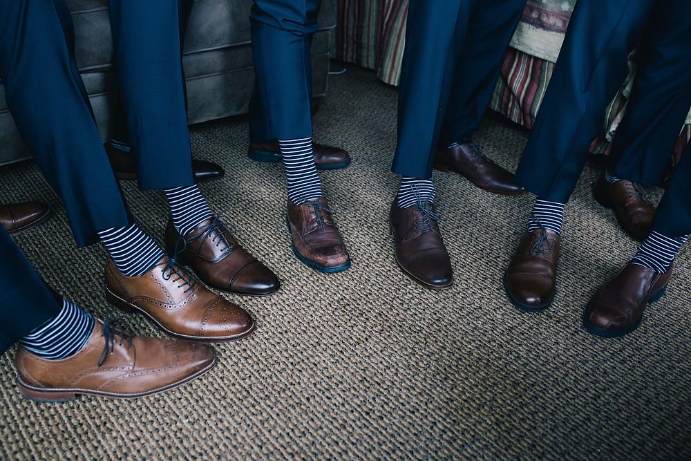 Stylish groom and groomsmen at Alyeska wedding