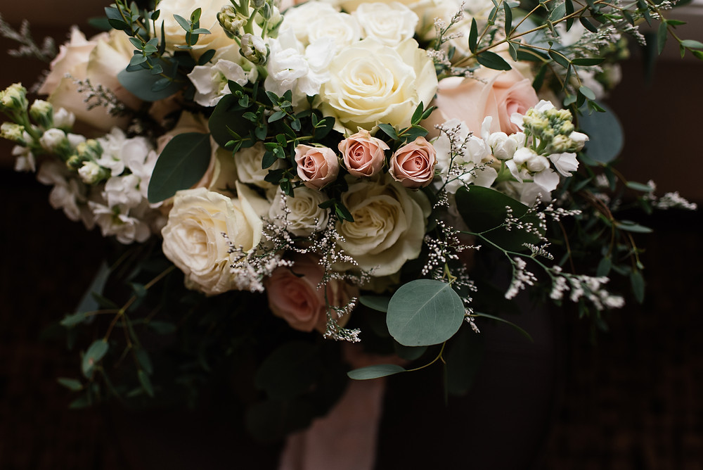 Alaska snowy winter elopement with gorgeous blush roses and vintage styled bridal bouquet