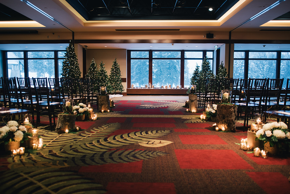 candlelit wedding ceremony with floral, tree stumps and trees in the columbia ballroom