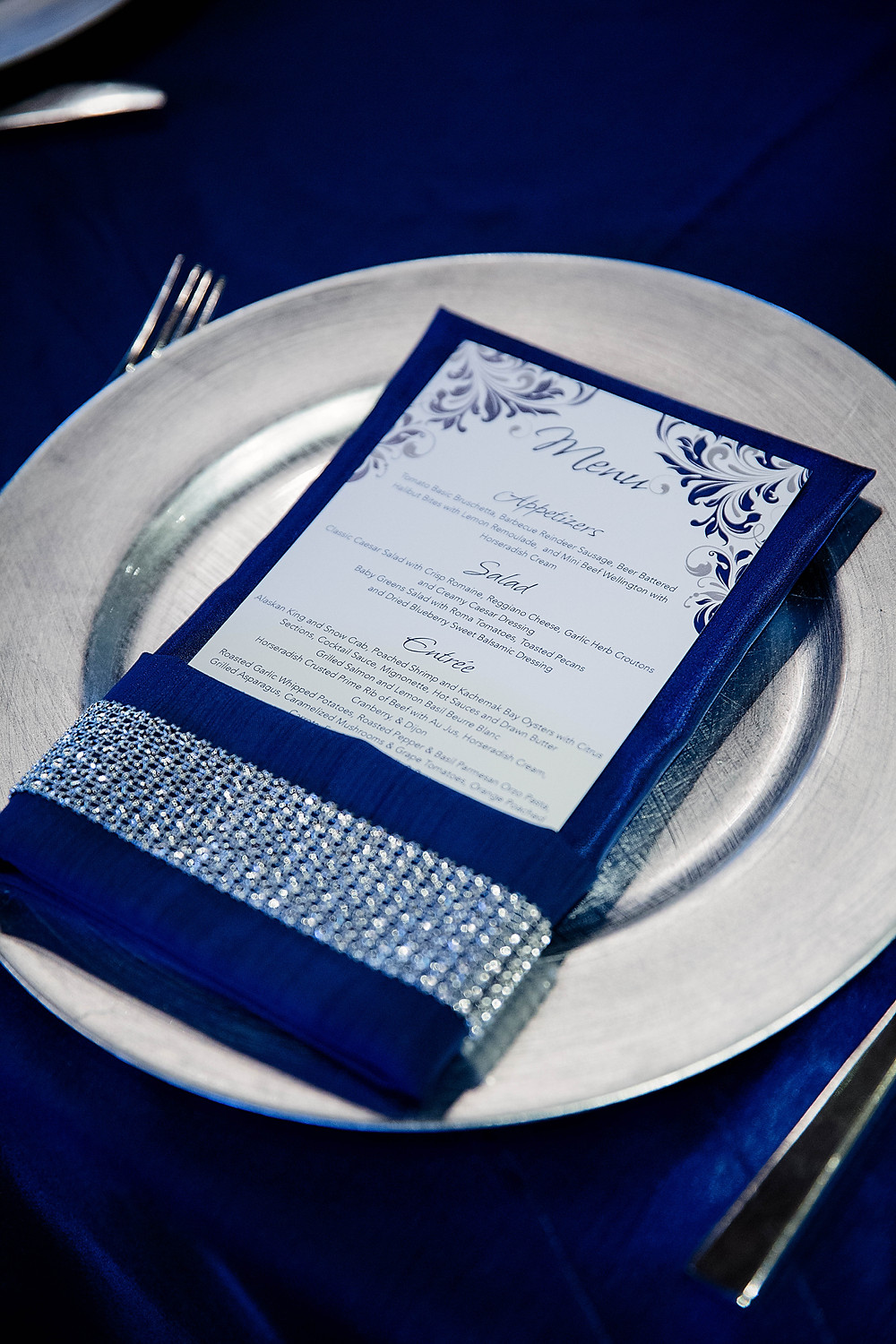 Navy napkin with crystal wrap on silver charger