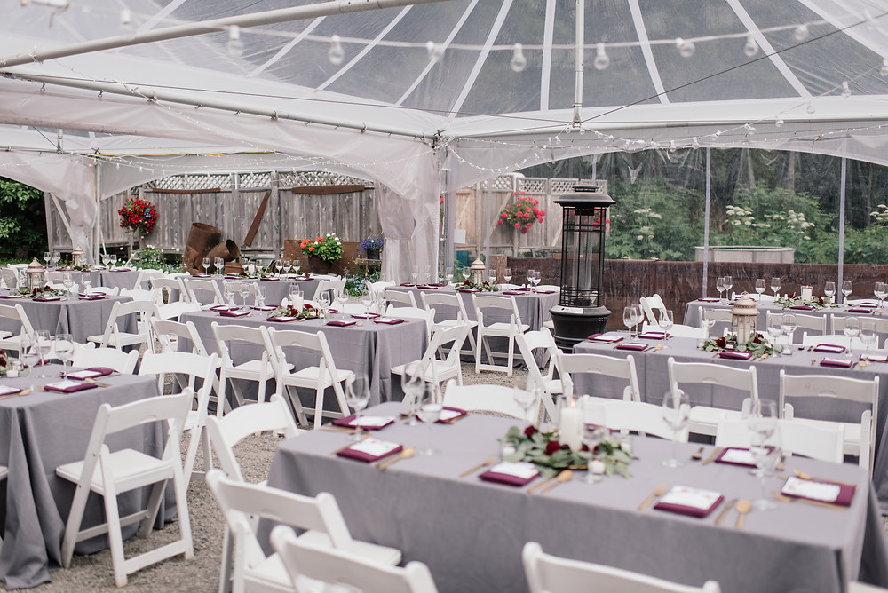 charcoal table clothes and raspberry napkins at Crow Creek Mine reception tent