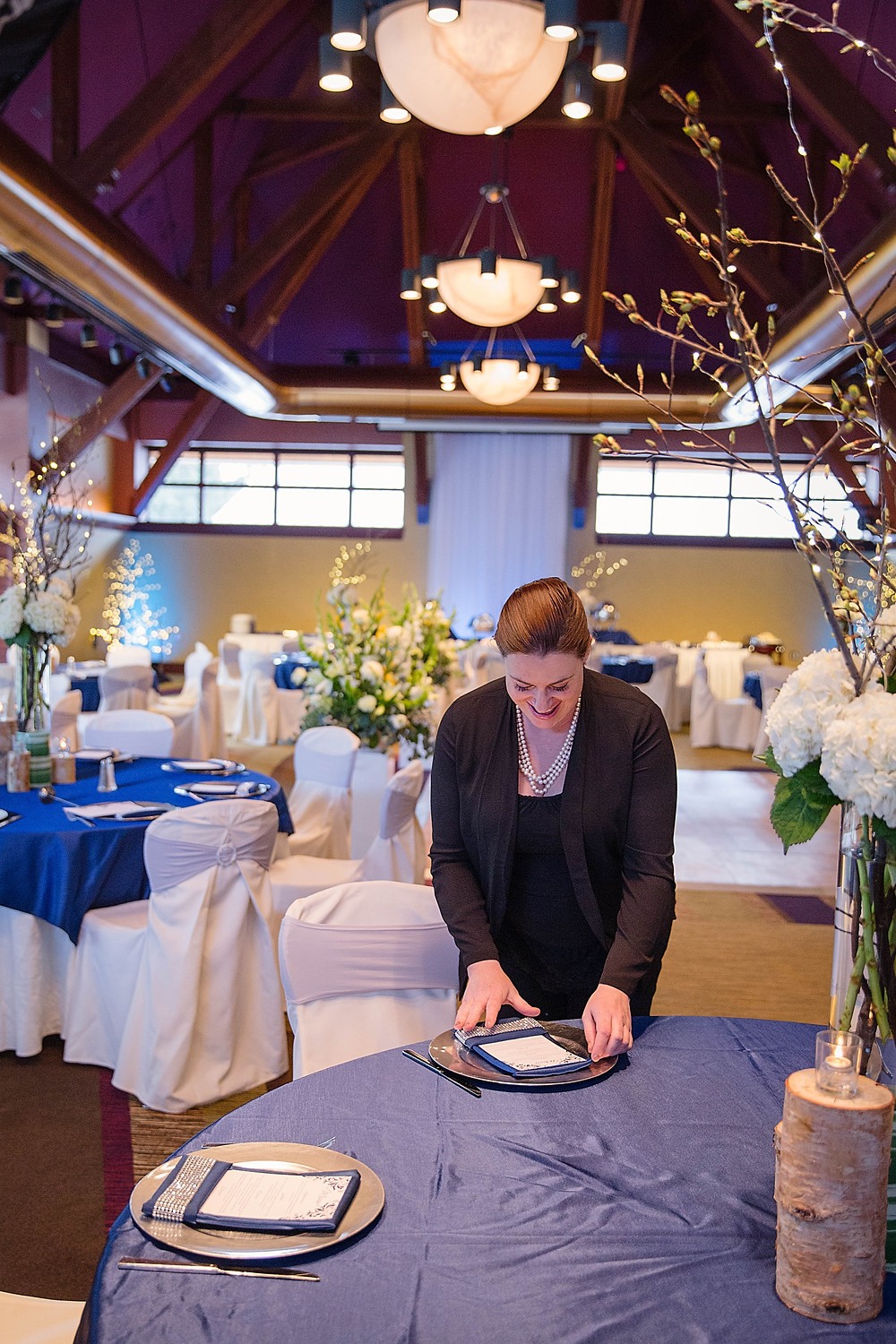 Rebecca Kopperud setting a place setting at Alyeska Hotel