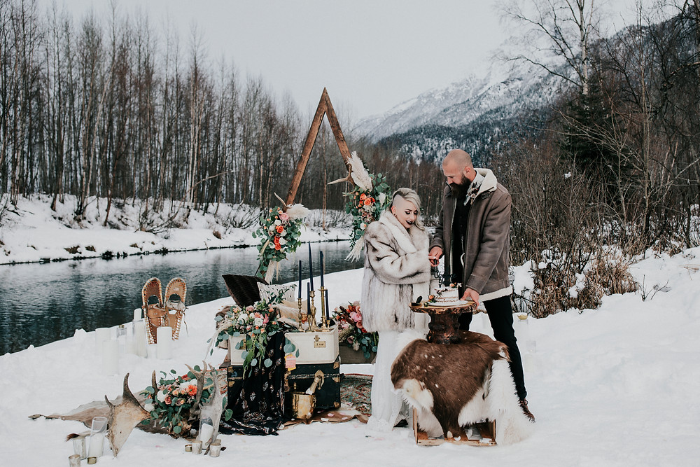 Cut the cake in the wilds of Alaska with styled elopement with sweet heart table set up