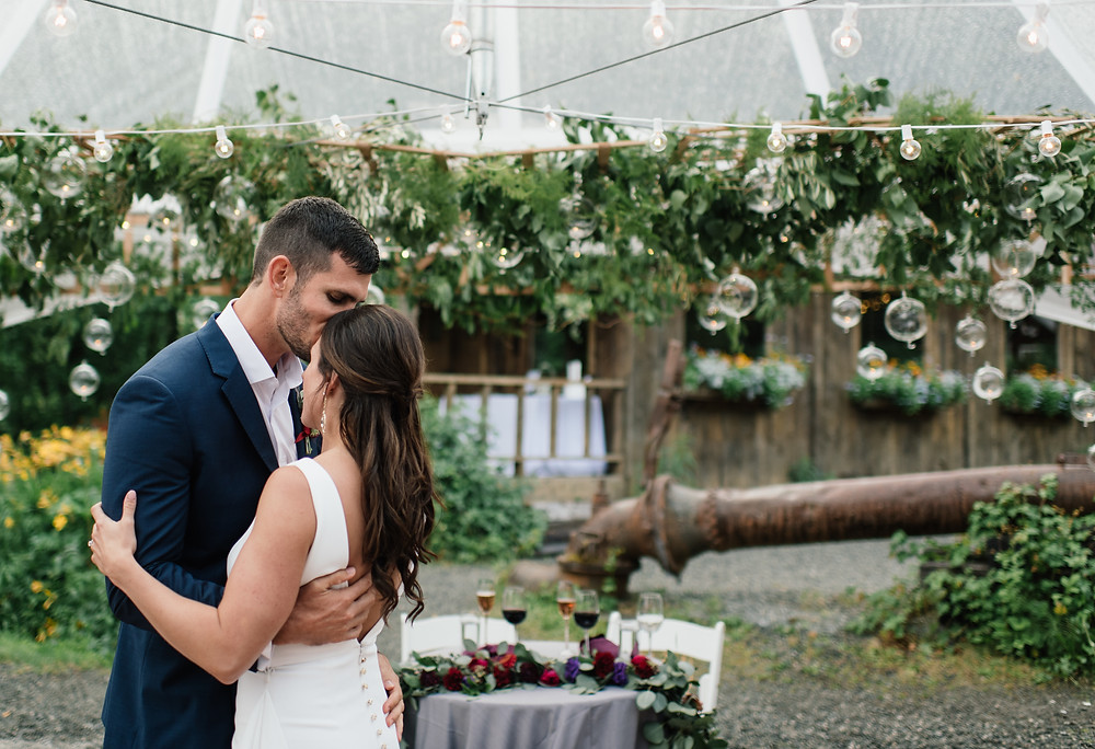 20' greenery chandelier over the sweet heart table