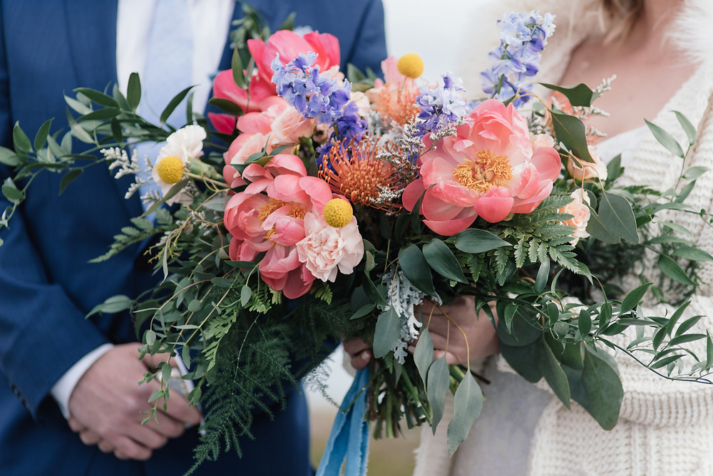Alaska coral peony bridal bouquet with larkspur, designed locally