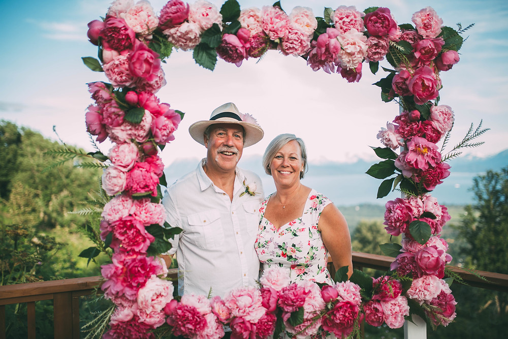 floral photobooth frame with view of ocean