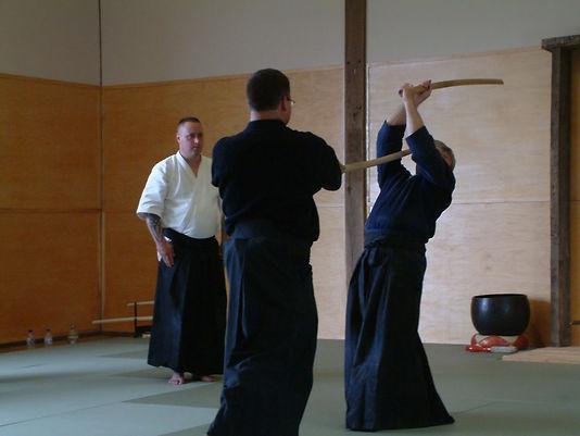 Students practicing an Kenjutsu (kendo) martial arts technique in the dojo