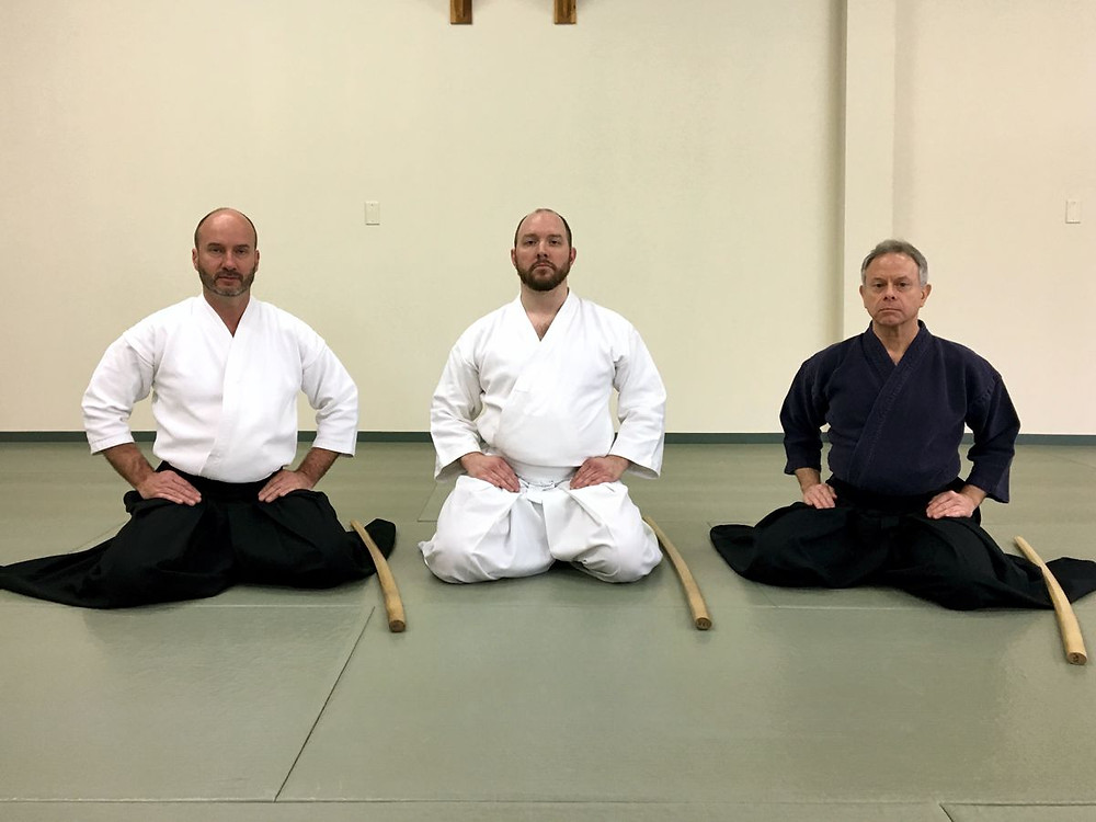 Martial Arts Student John Butz in Itto Tenshin-ryu getting a promotion (to Chukyu) at Itten Dojo, in Mechanicsburg PA. Visually to his left and right are Messrs. Alan Starner and his Sensei Robert Wolfe, respectively