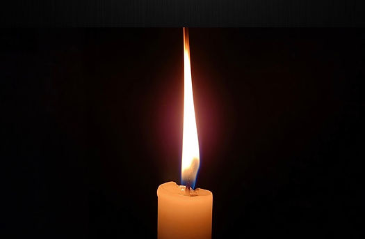 lit taper candle