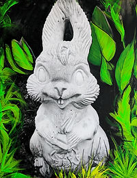 Photograph of a stone rabbit with painted plant background