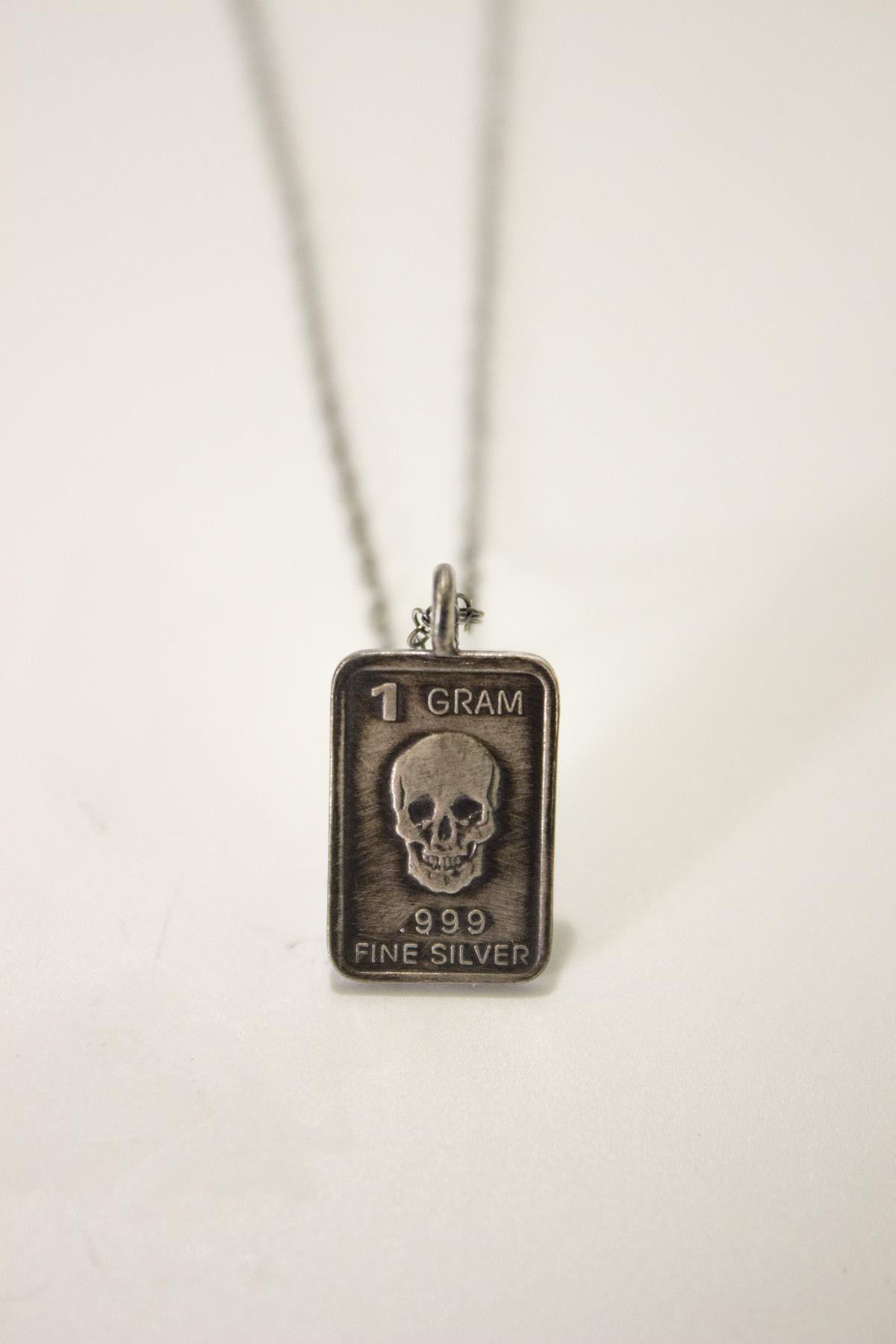 skull gram necklace