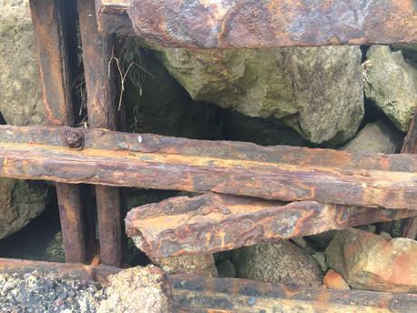 Rusty iron on the sea shore