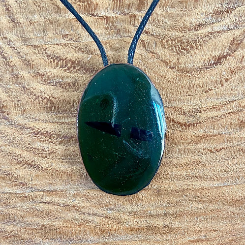 Vitreous enamel on copper oval pendant -dark translucent green