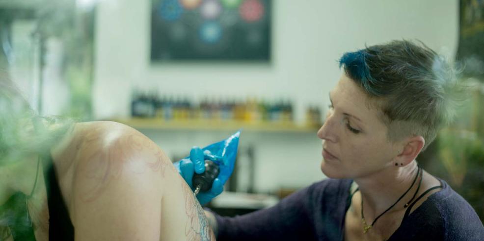 Estelle tattooing in her Ocean Ink Tattoos studio
