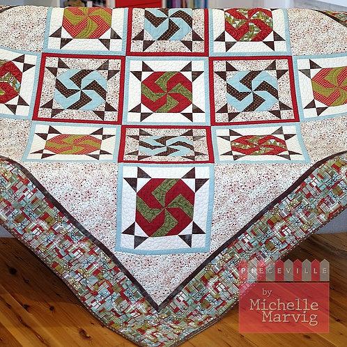 Rolling Pinwheel Christmas Quilt