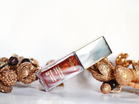 Рождество Clarins: Instant Light Lip Comfort Oil #09 Red Berry Glam