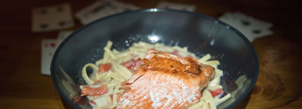 Alaskan Sockeye Salmon over red pepper scampi and linguine.