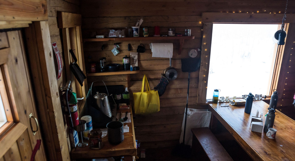 The kitchen and dining area of the cabin.