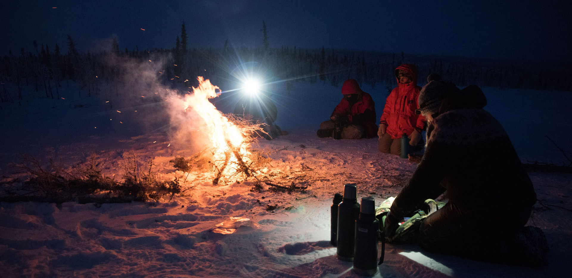 Preparing hot drinks by the fire.