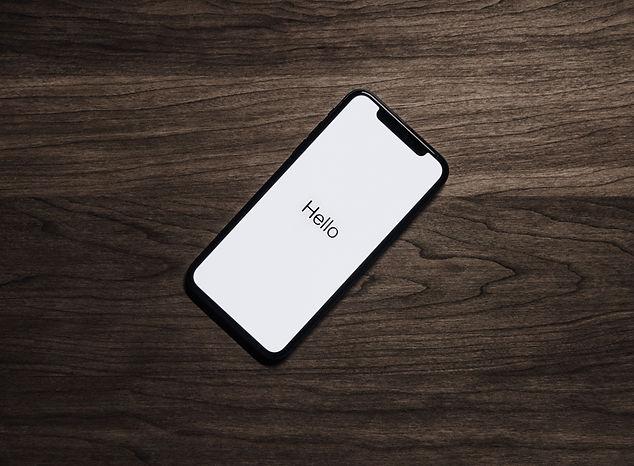 black-iphone-7-on-brown-table-699122.jpg