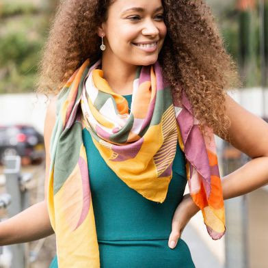 Vibrant graphic flower print scarf in mustard and orange