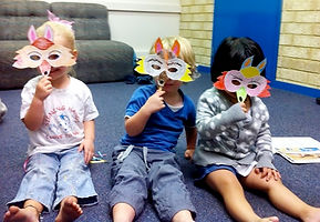 Group of children do craft in Auslan Signing Hands class