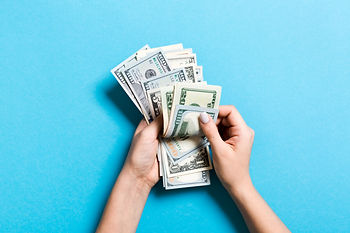 top-view-female-hands-counting-money-var